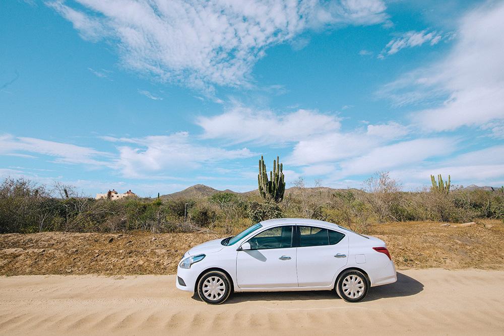 white car in the desert