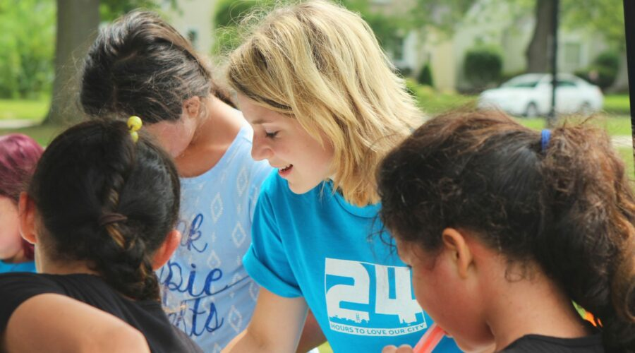 Blonde woman wearing a blue t-shirt while volunteering