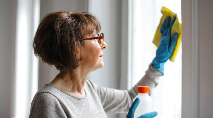 Woman cleaning wearing gloves