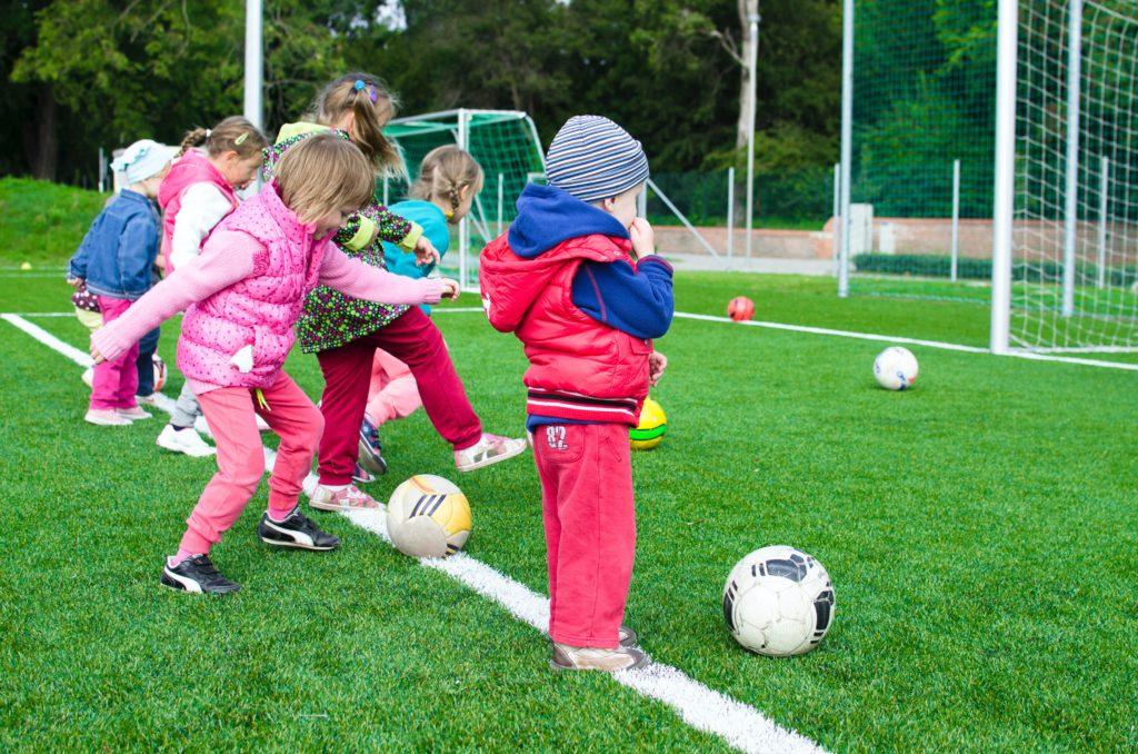 Kids paying soccer