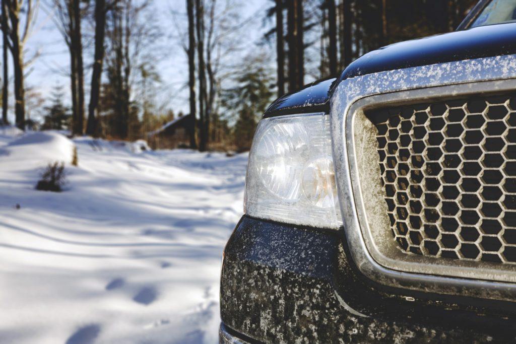 Black SUV in snow