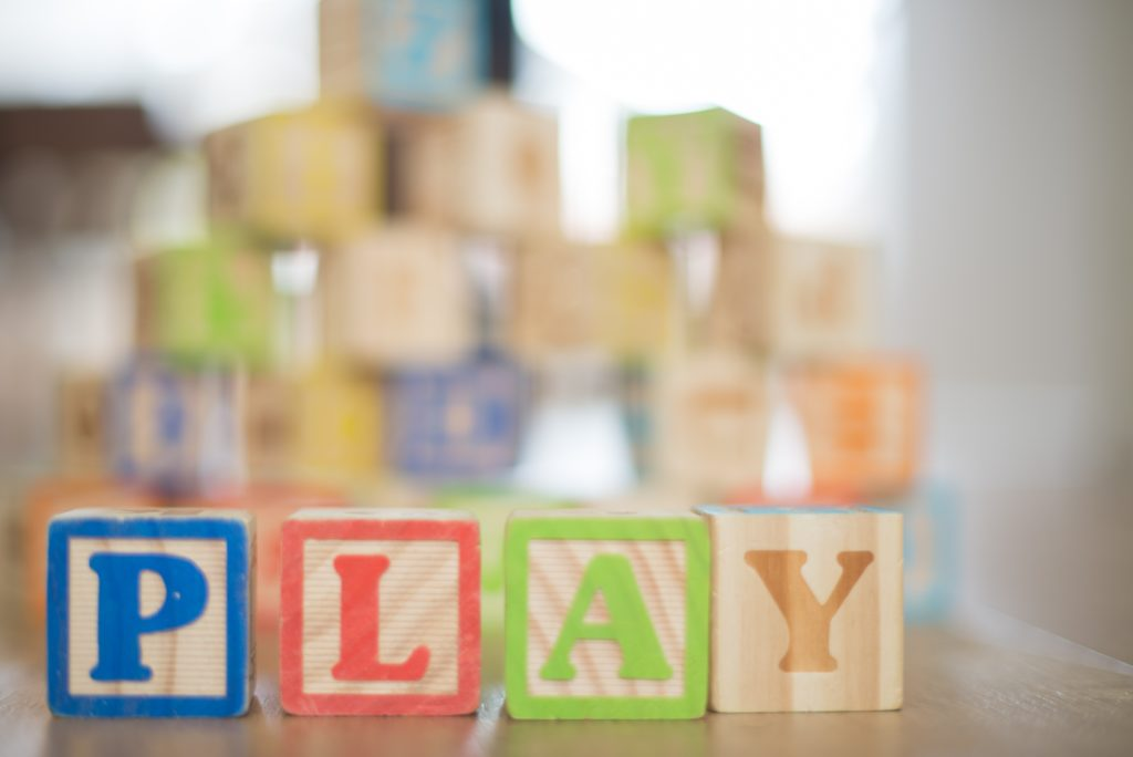 Play spelled with blocks